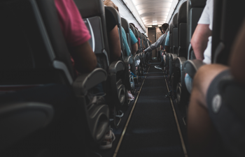 people-sitting-on-plane-chairs-1387551